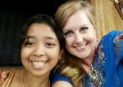 The author with the daughter of a Bhutanese refugee, at a wedding in Ohio.