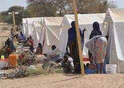 refugees prepare food and go about their daily lives at a UNHCR camp in Baga Sola, Chad