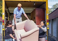 Volunteers help move furniture for newly arrived refugees in Toledo, Ohio.