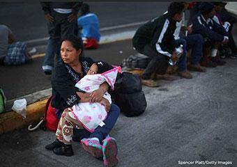 Mother and child at border seeking asylum
