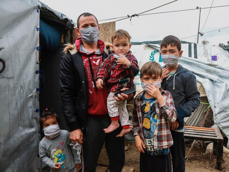 A refugee family at the Moria refugee camp in Greece during the COVID-19 outbreak.