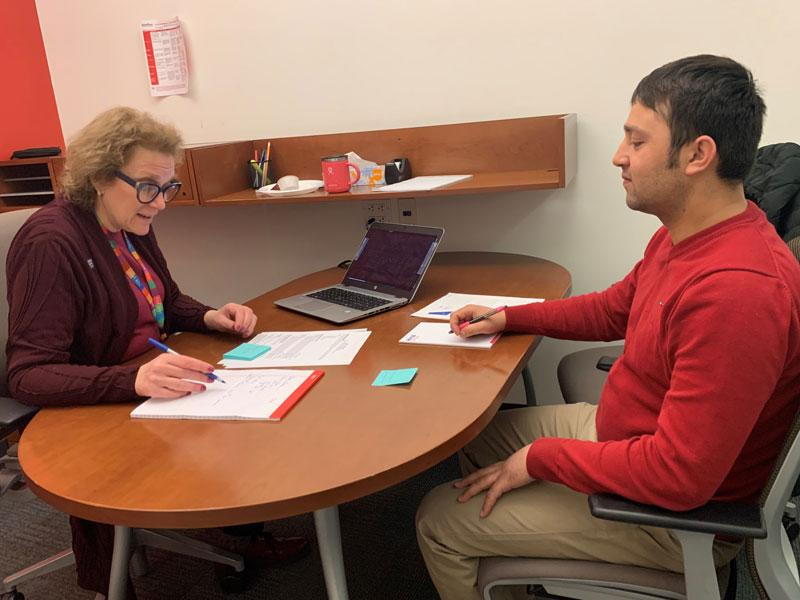 A HIAS client works with a volunteer from Accenture to review his resume and practice a mock interview.