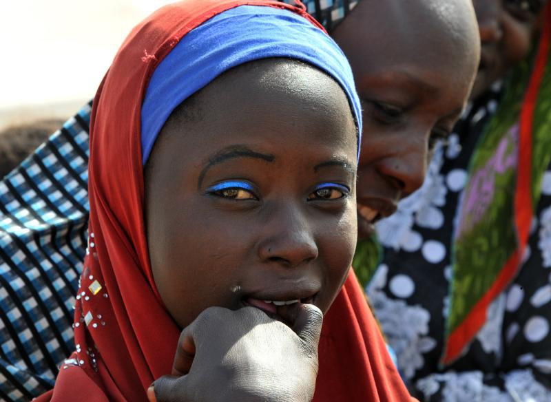 A young girl, a Nigerian refugee, in a United Nations refugee camp in Baga Sola by Lake Chad, which borders Chad, Nigeria, Niger and Cameroon.