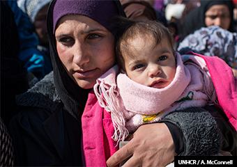 Syrian refugee mother and child. (UNHCR)